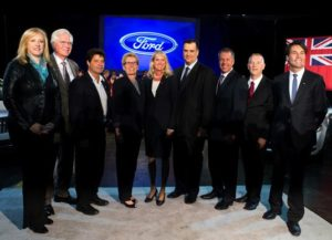 left to right: Lisa Raitt, Minister of Transportation;  Terence Young, Oakville Tory MP; Jerry Dias, National President of Unifor; Ontario premier Kathleen Wynne; Dianne Craig, president and CEO, Ford of Canada; James Moore, Minister of Industry; Joe Hinrichs, Executive VP and Ford president of The Americas; Will Cowell, plant manager; and Eric Hoskins, Provincial Minister of Economic Development