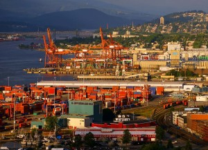 Vancouver harbour, showing container cranes and grain export terminal