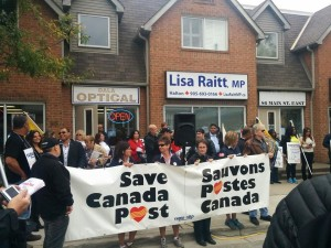 Postal workers and supporters deliver thousands of postcards opposing the cuts to home delivery at Lisa Raitt's Milton riding office. September 12, 2014.