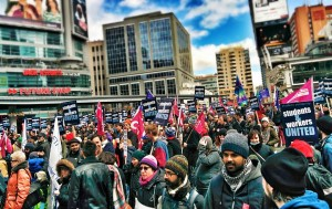 Striking academic workers rally in downtown Toronto