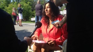 Lynda Kitchikeesic speaking with reporters outside her home.