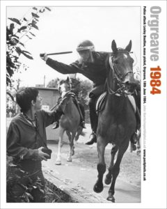 Photographer Lesley Boulton narrowly avoids a police baton. This photo by photojournalist John Harris was only printed in one British paper covering the Battle of Orgreave.
