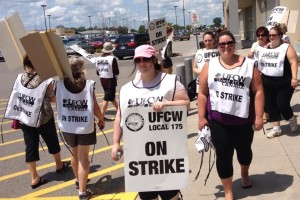 After years of wage concessions, workers at Canada's largest grocery chain voted down a first deal, forcing their employer back to the table to do better. Members walked a picket line outside a Loblaws store in Chatham, Ontario. Photo: Derry McKeever.