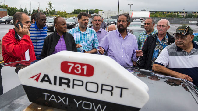 Ottawa's airport taxi drivers protesting and blockading Airport Parkway, September 2015.