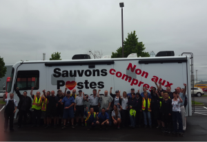 CUPW members in Quebec City with the Save Canada Post bus