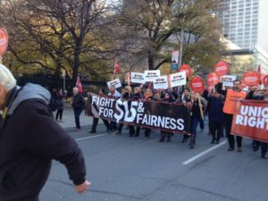 Fight for $15 and Fairness march heads towards Queen's Park during the OFL Convention
