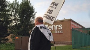 Grocery store workers on strike in Ontario's Essex, Lambton and Kent counties this past July.