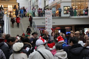 Singing carols about decent work at the Eaton Centre