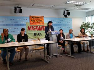 Migrant justice advocates speak at a press conference May 31, 2016, in Vancouver, BC.