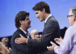 Prime Minister Justin Trudeau and Unifor President Jerry Dias embrace during the Unifor convention in Ottawa on Wednesday, August 24, 2016. iPolitics/Matthew Usherwood