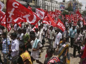 Indian workers participate in a rally during a nationwide strike called by trade unions in Hyderabad