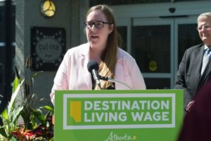 Alberta's NDP Labour Minister Christina Gray announcing $15 minimum wage plans in September, 2016.
