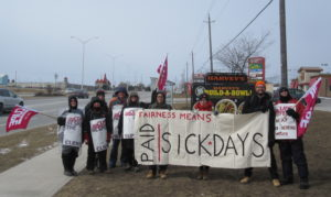 Fight for $15 and Fairness activists on the CHS picket line in Kingston, Ontario