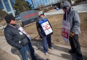 Striking Chronicle Herald reporter Kelly Shiers talks with colleagues Roger Taylor and Elissa Barnard on the picket line in front of the Herald offices on Joseph Howe Drive in Halifax on March 7. (TIM KROCHAK / Local Xpress)