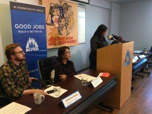 Moderator Michelle Silongan addresses the press.